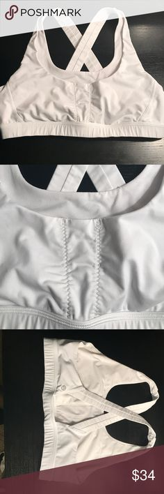 Lululemon athletica white racerback sports bra Calvin Klein Performance Quick Dry Sports Bra Size 12 Tag removed Gently worn, no flaws  Thank you for checking out my closet💫 lululemon athletica Tops