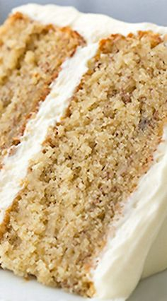 Banana Cake with Fluffy Cream Cheese Frosting ~ This cake is like banana bread in fluffier form, layered with a light and tangy cream cheese frosting