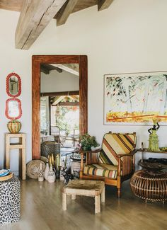 A Mario Schifano painting hangs above a chair upholstered in Missoni fabric. Wall Street Journal, Upholstered Chairs, Cozy House, Missoni, Oversized Mirror, Living Spaces, Relax, Vacation, Interior Design