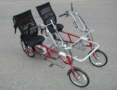 Quadribent™ Side-by-Side Recumbent Bikes. Better than sitting behind someone watching their patootie pedal away. Love the carriage on the back for items or pets or a nice picnic basket. Coolness. Pricy at 2K+ but would bring years of fun. Thinking the commute to work would be a hoot.