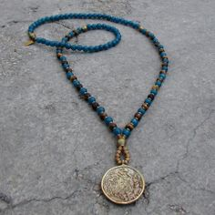 Blue sapphire jade with faceted tiger's eye for prosperity necklace.  #necklace #teal #gemstones #mala #yoga #meditation #new #tibetan #bohochic