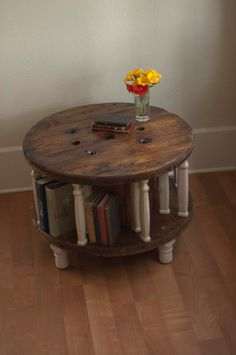 Handmade upcycled spool coffee table with reclaimed spindle dividers - good idea for the one I have in the shed!!!