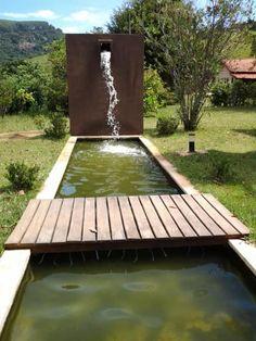 Espelho de água: Casas coloniais por Mina Arquitetura & Construções
