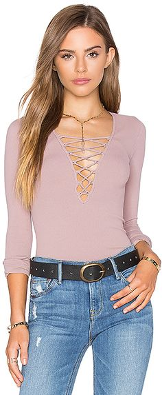 Rose Free People Stretch Lace Up Top Was $58 Now $31-$58 At Revolve Front lace-up closure Stretch fir rib knit fabric 92% nylon, 8% spandex https://api.shopstyle.com/action/apiVisitRetailer?id=536426948&pid=uid841-37799971-81