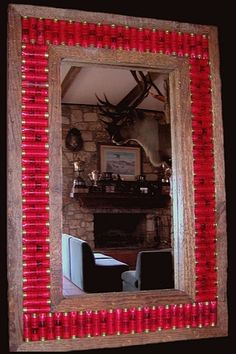 Shotgun shells! Ha ha ha...that might also be called a redneck mirror! That would look awesome in a hunting cabin. I'm positive NO Man would nottt like that.