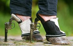 Top 10 WTF Pictures of the Day – November 9th 2012 Some WTF hoof shoes with gun heels. STYLE! – Odd Stuff Magazine
