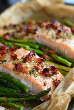 Easy, light, and unbelievably delicious baked salmon and asparagus dish. Juicy, flaky salmon is baked with asparagus in a sun-dried tomato lemon sauce.