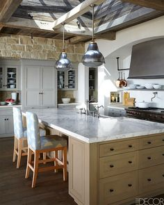 large kitchen with a buttery limestone wall