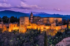 Buy Illuminated Arabic Alhambra palace in Granada,Spain by on PhotoDune. Illuminated Arabic Alhambra palace in Granada,Spain with Sierra Nevada snowy mountains in background Facts About Spain, Alcazar Seville, Cities, Spain Travel Guide, Julian Alps, Granada Spain, Saint Nicholas, Europe Photos, Amazing Sunsets
