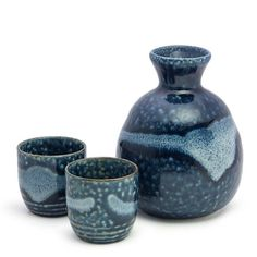 Enjoy traditional Japanese sake using this authentic set of cups and bottle for serving yourself or guests. Their ceramic construction is as ornate as it is durable, withstanding both dishwasher cleaning and microwave use. Japanese Plates, Japanese Sake, Porcelain Black, Sake Bottle, Sushi Set, Clean Dishwasher, Pottery, Ceramics, Blue