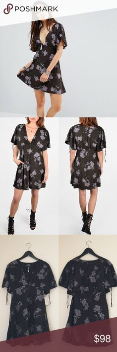 Free People Black Floral Melanie Dress A pretty floral print patterns a lightweight fit-and-flare dress styled with gentle shirring at the bodice and fluttery, elbow-length sleeves.   •Size 4; true to size  •Hidden side pockets  •New with tag  •NO TRADES/HOLDS Free People Dresses Mini