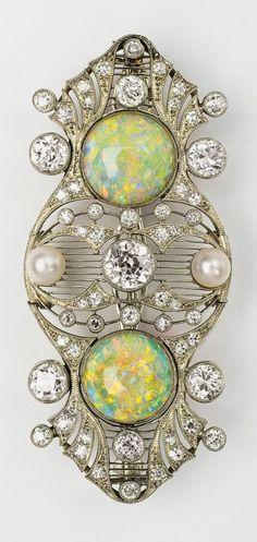 A Belle Epoque platinum, opal and diamond brooch. 5.5cm long.