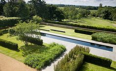 Pool and Gardens at The Manor, Great Haseley in The UK by BHSLA
