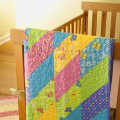 Brightly colored half-squared triangles produces vibrant diamonds in a  quickly pieced baby quilt, using whimsical prints like these from the  Butterfly Fling collection designed by Me & My Sister for Moda Fabrics.