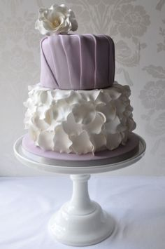 Lavender petals & pleats  A 2-tier black forest cake (chocolate cake soaked in cherry brandy and filled with black cherry preserve and vanilla buttercream), which is decorated with sugarpaste pleating and flowerpaste rose & petal ruffles.