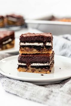 Slutty Brownies are an over-the-top triple decker mashup of chocolate chip cookie dough, double stuff Oreos, and fudgy brownies all in one dessert! This is one dessert that is hard to resist, and you might feel guilty about it afterwards, but you can't help wanting more. #brownies #oreos #chocolatechipcookies #bars #best #homemade #fromscratch #easy #dessert Slutty Brownies Recipe Easy, Brownie Recipe Video, Fudgy Brownies, Brownie Recipes, Oreo Bars, Chocolate Chip Cookie Bars, Baking Recipes, Vegan Recipes, Best Food Ever