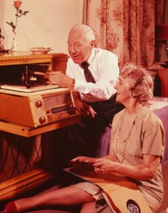 Mature couple with hi-fi by H. Armstrong Roberts, 1960s.