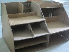 I love this site. Reusing cardboard for organizing your work space.