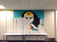 8,024 Post-It notes create superhero portraits at eBay Enterprise office   Daily Mail Online