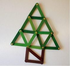 Geometric Popsicle Stick Christmas Tree Ornament Craft | Paint some popsicle sticks and turn them into a shapely DIY ornament.