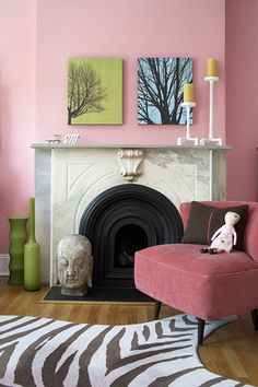 Pink bedroom in Park Slope: Marble fireplace + modern art by xJavierx, via Flickr  (I'd get rid of the doll and candlesticks need to be more interesting color.  Love the zebra rug with pink chair)