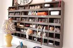 Pallet storage. This is a vintage post organizer that I would love to have, but I am using this as inspiration for my own pallet organizer creation for Emry's craft nook :) Mason jars for embellishments and ribbon storage on shelves.