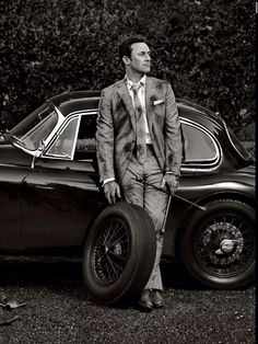 "Jon Hamm photographed for the ""Well, That Was One Hell of a Ride"" editorial, (alongside a 1959 Jaguar XK150) in Los Angeles, by Sam Jones for Vanity Fair, June 2014."
