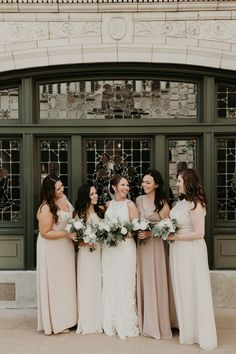 Blush bridesmaid dresses and greenery bouquets