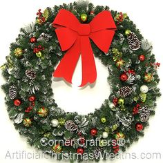 48 inch Christmas Magic Wreath - 2013 - 4 Foot Decorated Christmas Wreath with pine cones, frosted tips, colorful ornaments and more... finished with a contemporary cut semi-rigid weatherproof bow.  Large Christmas Wreaths #LargeDecoratedChristmasWreaths #ChristmasWreaths #DecoratedChristmasWreaths #LargeWreaths
