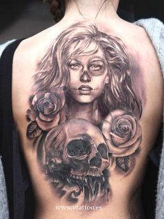 ~Sugar Skull Girl~.... amazing tattoo. i love the way its so dark on one side but beautiful on the other.