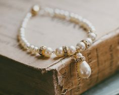 A gold version of the ever popular and classic Nicole pearl bracelet. A neat teardrop pearl to the front gives great definition to this design. Rose Gold Accessories, Wedding Hair Accessories, Luxe Wedding, Gold Wedding, Wedding Details, Pearl Bracelet, Beaded Bracelets, Wedding Earrings, Wedding Bracelets