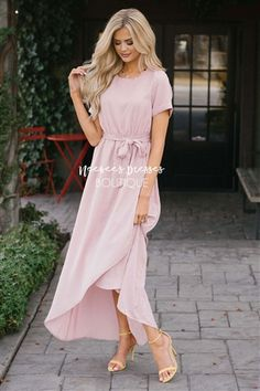 Our coveted Maleah Dress will be an instant sell out! If you have had your eye on this dress, do not wait to purchase it or it will be gone! Beautiful dusty pink dress has short sleeves, a gathered waist, waist tie sash and a wrap style skirt. Lined.