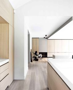 #kitchen design #modern #minimal #lightwoodfloors #whitekitchen - JUMA Architects Transformed a Bungalow into a Contemporary Villa - InteriorZine