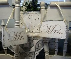 Vintage signs that say Mr. & Mrs. for our chairs, also ones that say our names/wedding date with the peeled paint look