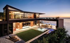 The sleek lines and lack of walls of this modern luxury home give it a seamless blend with the ocean it overlooks.