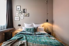 A grouping of framed prints and a woven bedspread add character.