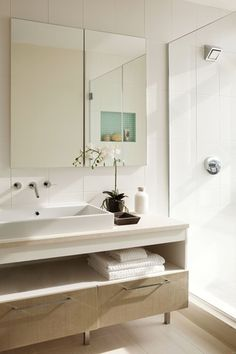 Contemporary 3/4 Bathroom with frameless showerdoor, Flush, European Cabinets, Limestone counters, High ceiling, Vessel sink