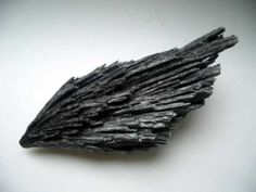Black Kyanite ~ It is called the Revival Stone. It is a stone of such a high vibration that is affects the aura of anyone who is in its presence. It grounds spiritual energy and energizes the body. It has the ability to open and cleanse the earth start chakra. Meaning it is able to replace negative energy with positive energy in the subtle bodies. Black Kyanite is a great stone for healers <3