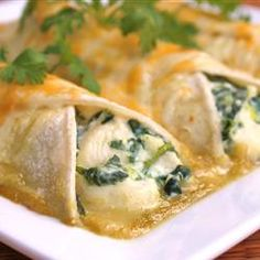 Spinach Enchiladas Recipe - Allrecipes.com.  Fabulous dish.  I serve with a Green Enchilada sauce.  Also I used cottage cheese instead of ricotta, with a bit a sour cream in the mixture.  Don't be afraid to use extra spices or green chilies.