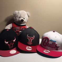 """Bundle of 3 Bulls Hats and a """"Bulls"""" Build-a-Bear. All hats are snapbacks.. First one is New Era Gray with a Red Bull, Outlined with White, """"Blowing"""" """"Windy City"""" out of its nose (white with red outline) bill is red, still has new era/ 9fifty sticker on it. Has all original stickers. Second one is White, has """"Bulls"""" with a bull at the end, stitched in pink,blue, and purple, says chicago in blue. bill is pink. new era brand. all original stickers. last NWT is black with a bull in…"""