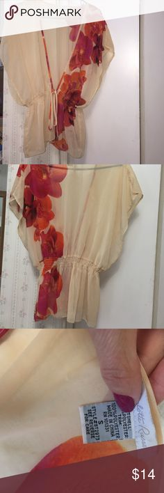 Beautiful floral semisheer  top - good condition!! Beautiful floral semi- sheer top - ivory - orange - fuchsia - elastic w tie - can fit any size - tiny hole from a pin that I put in it- (as shown in 3rd pic)nothin major😱- can be worn w a bra - Cami - tank under - take your pic - 100% poly- worn a few times - good condition -gorgeous !!🌺 Charlotte Russe Tops Blouses