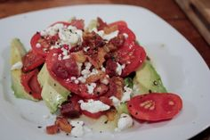 Heirloom tomato and avocado salad with bacon and goat cheese.