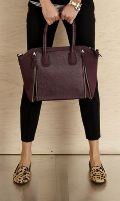 Structured vegan leather satchel with faux snakeskin and zipper detailing. SO chic.