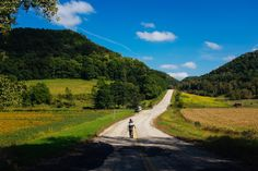 A fly fisherman walks down a county road near the town of Viroqua, Wisconsin. The driftless region of Wisconsin provides some of the best trout fishing in country.