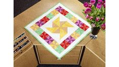 This playful and fun pinwheel quilt features piecing and echo quilting on a Baby Lock sewing machine and is made from triangles cut using the Accuquilt Go! Small Quilt Projects, Quilting Projects, Fun Projects, Sewing Projects, Quilting Ideas, Pinwheel Quilt, Sewing Appliques, Small Quilts, Quilting Tutorials