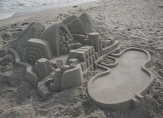Sand Cities: Geometric Architecture Sculpted from Beaches