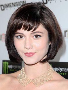 Mary Elisabeth Winestead with a glossy, dark chin-length bob with bangs