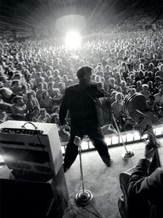 Elvis Before He Was King - Stage Presence Wertheimer captured the frenzy of Presley's early performances at this July 4, 1956, gig at a Memphis baseball stadium.