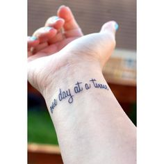 One Day At A Time Wrist Tattoos Center ❤ liked on Polyvore