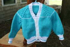 What sweet pictures you could take of your baby boy in this!  Little letterman's style sweater Knit Baby Boy Sweater 12 months by BlissfulFiber on Etsy, $30.00